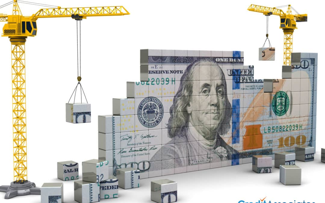 Construction cranes building a 100 dollar bill