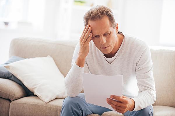 Man Struggling with Credit Card Debt