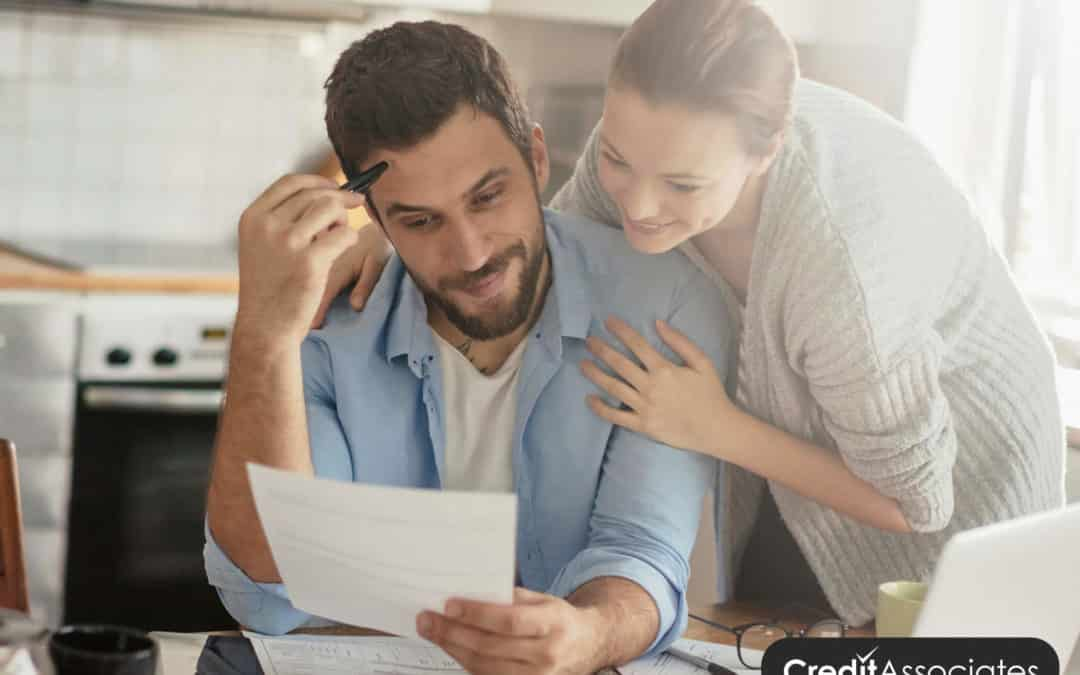 Couple looking over documents to answer the question is debt settlement worth it